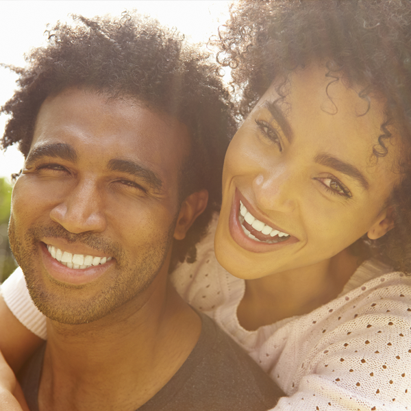 Black couple woman hugging man smiling