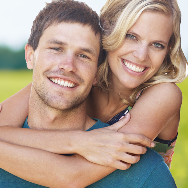 woman hugging mans back smiling