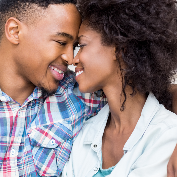 Young black couple head to head smiling